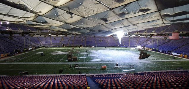 The teflon roof at the Minnesota Vikings' Minneapolis Metrodome stadium collapses under 17 inches of snow (Reuters)