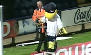 Preston mascot Deepdale Duck is escorted away from the pitch by a steward at the Derby match (Sky)