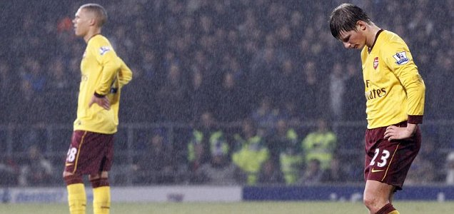 Why does it always rain on me? The recent form of Andrey Arshavin (right) has been poor (Reuters)