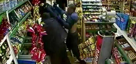 Scare: A robber pulls out a gun before the fight-back begins PA/Pixel