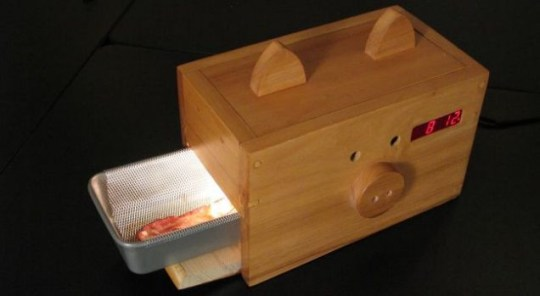Breakfast in bed: The Wake n' Bacon alarm clock (Picture: Caters)