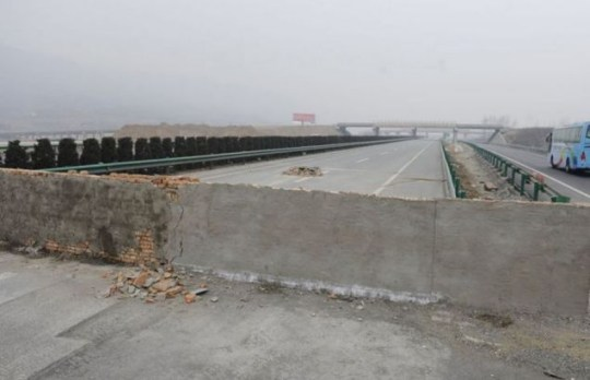The wall in Xian, Shaanxi province, western Chinawas built to protect road workers, but no one told the drivers about it (Picture: CEN)