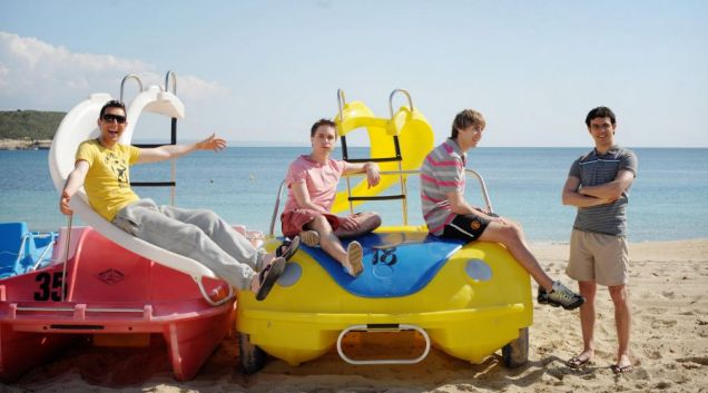 The Inbetweeners boys pose on the beach