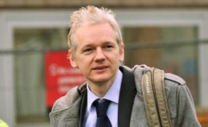 Wikileaks founder Julian Assange has warned people about posting information on Facebook (PA)
