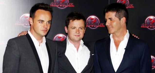 My boys: Ant and Dec pose with Simon Cowell as they launch Red Or Black at a hotel in London Picture: PA