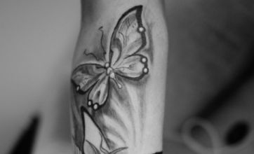 Cher Lloyd shows new butterfly tattoo to Twitter
