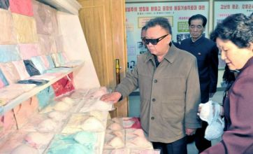 Kim Jong-Il looks at many bras, pencils