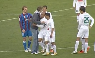 Roberto Carlos hugs and signs an autograph for Russian pitch invader