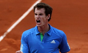 Andy Murray fights through the pain to take Viktor Troicki to fifth set