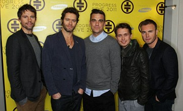 Take That stuck on giant robot during Manchester concert