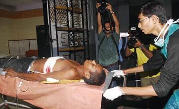 Terror strikes Mumbai again as bombs kill 21 and wound over 100