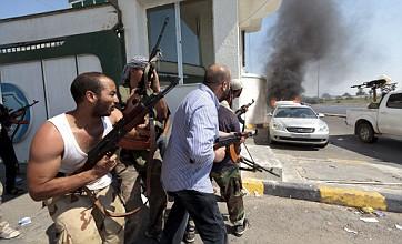 Libyan rebels storm ten buildings after Muammar Gaddafi tip-off