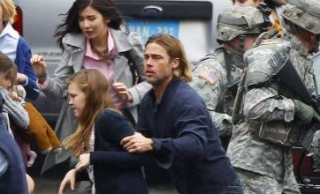 Brad Pitt saves woman from zombie stampede on the set of World War Z