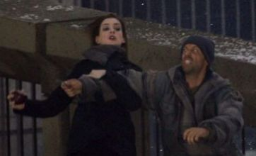 The Dark Knight Rises photo shows Anne Hathaway fighting a thug in LA