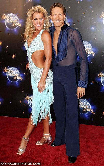 Natalie Lowe and Brendan Cole pose on the red carpet for photos