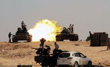 Nato: Bombing of Libya will continue despite collapse of Gaddafi's regime