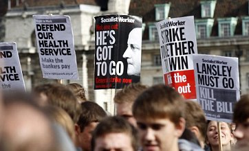 Thousands take to Westminster Bridge in protest over NHS reform bill