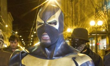 Police arrest masked 'superhero of Seattle' after pepper-spray incident