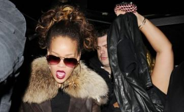 Rihanna 'told off by bouncers after touching topless lapdancers'