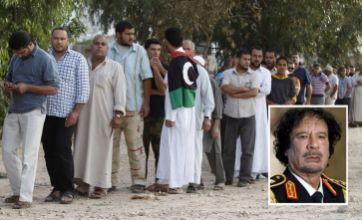 Libyans queue to see Muammar Gaddafi's body in Mistrata meat store