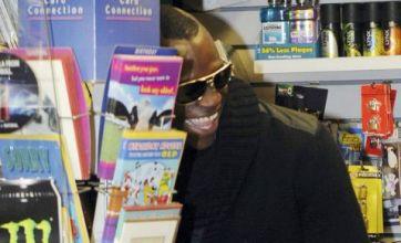 Mario Balotelli caught flicking through porn magazine in newsagents