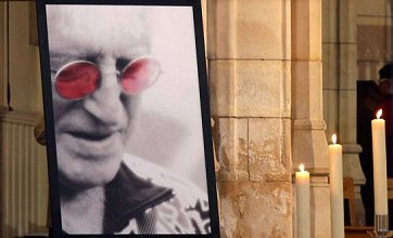 Thousands of mourners turn out for the funeral of Jimmy Savile in Leeds