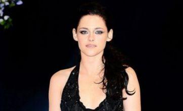 Kristen Stewart and Lauren Pope vie for best dressed at Twilight premiere