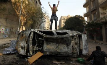 Egypt turmoil deepens as politicians offer to resign after 30 die in clashes