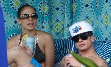 Jennifer Lopez cuddles up to Casper Smart on sunshine break to Hawaii