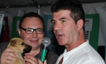 Simon Cowell does his bit for animals at charity dog auction in Barbados