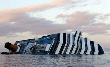 Costa Concordia: 12th body found as passengers lodge multi-million lawsuit