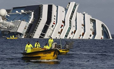 Costa Concordia death toll rises to 13 as divers discover woman's body