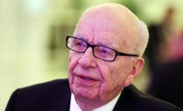 Rupert Murdoch asserts 'total commitment' to The Sun after arrests