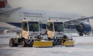 Heathrow axes a third of flights as snow and ice creates travel havoc