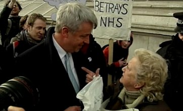 'Greedy' Lansley confronted by NHS protester before crucial summit