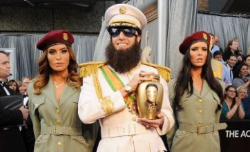 Sacha Baron Cohen turns up to Oscars 2012 with 'Kim Jong-il's ashes'