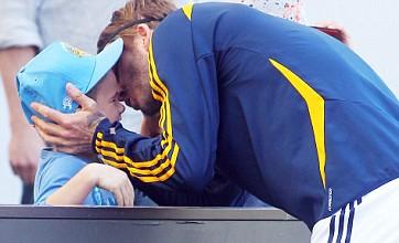David Beckham plays doting dad as his family watches LA Galaxy game