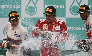 Fernando Alonso masters rain to take shock Malaysian Grand Prix win