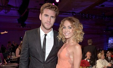 Miley Cyrus sparks Liam Hemsworth engagement rumours at fight night