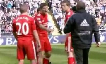 Steven Gerrard shoos Kenny Dalglish off the pitch during Newcastle match