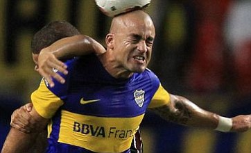 Boca Juniors players fight with Tigre fans in car park