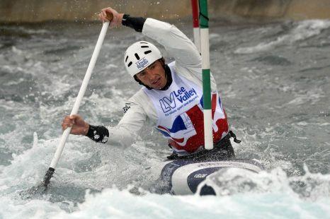 David Florence racing in a canoe