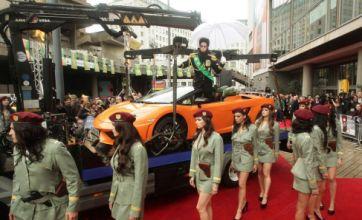 Sacha Baron Cohen hits The Dictator premiere in flash orange Lamborghini