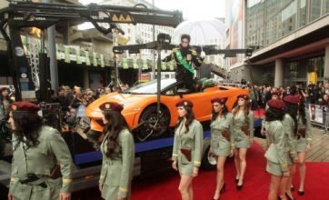 Sacha Baron Cohen hits The Dictator premiere in flash orange Lamborghini