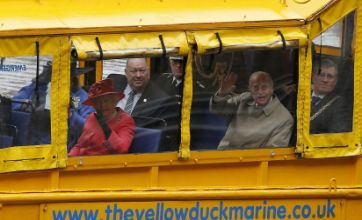 Queen makes a splash riding duck boat in Liverpool on Diamond Jubilee tour