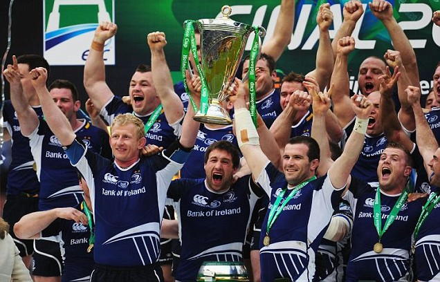Leo Cullen (L) and Shane Jennings (R) lift the trophy in celebration with Leinster team mates