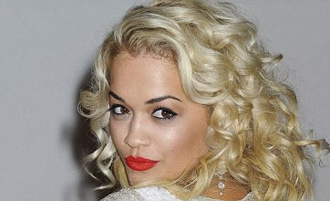Rita Ora holds on to top spot in singles chart with R.I.P