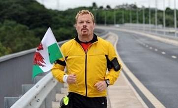 Eddie Izzard forced to cut short South African marathon challenge