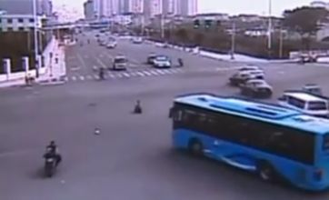 Chinese toddler survives riding scooter through busy intersection