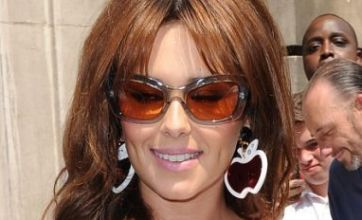 Cheryl Cole shows her quirky side as she steps out in apple earrings